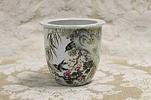 A Chinese porcelain vase with bird and floral