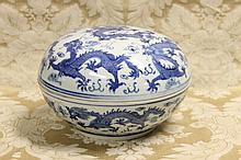 A Chinese hand painted blue and white lidded bowl