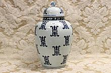A tall Chinese lidded vase with blue and white