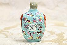 A Chinese porcelain scent bottle with jade stopper