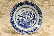 A Chinese blue and white plate having floral