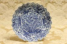 A Chinese hand painted blue and white plate with