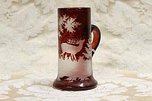 A bohemian glass stein with etched deer