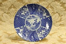 A Chinese hand painted blue and white plate.
