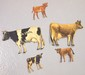 Tin DeLaval cows & calves: Holstein cow & calf, Guernsey cow & calf, Brown Swiss calf