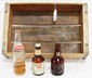 (4) Drink items: (2) rare early glass 7-UP bottles - 1 is full, glass Howdy bottle, wooden 7-UP case