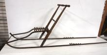Kicker dogsled with brass tag