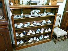 Victorian walnut open bookcase fitted four shelves and standing on a plinth base
