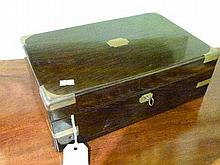 Victorian brass bound rosewood writing box, the hinged cover opening to reveal a fitted interior and to form a slope