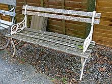 Early 20th Century slatted garden bench having wrought iron ends