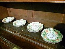 Nine early 19th Century English pearlware dessert plates, each decorated with strawberries and blossom on a pale green ground, some bearing pattern nu