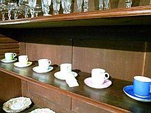 Set of six 19th Century Royal Worcester coffee cups and saucers glazed in six different pastel colours (one shelf)