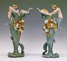 Pair of late 19th/early 20th Century Continental bisque porcelain vases, probably Austrian, each having a figural handle formed as a Nymph and with fr