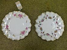 Two modern Royal Crown Derby plates decorated with the Royal Pinxton Roses and Royal Antoinette patterns
