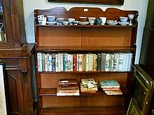 Late 19th Century mahogany waterfall bookcase fitted four shelves having shaped crest
