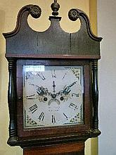 Early 19th Century oak and mahogany crossbanded longcase clock having square painted dial, date aperture, the hood having swan neck pediment and balus