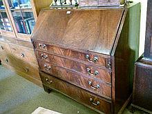 George III mahogany bureau, the fall flap revealing a shaped mahogany and string inlaid interior with baize writing surface, the base fitted four long