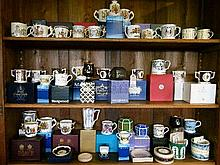 Large collection of mainly Royal commemorative tankards, two handled cups, money boxes etc, mostly with boxes (three shelves)