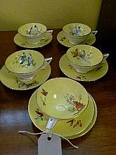 Minton's part tea set having hand painted decoration of flowers against a yellow ground, the base with printed puce mark