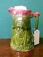 Late 19th Century Staffordshire Majolica green and pink glazed jug decorated in relief with a portrait of William Gladstone amongst oak leaves and aco