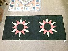 1960's period rectangular rug depicting two orange and yellow stars against a black ground