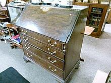 Early 19th Century oak bureau fitted fall flap and four long drawers having brass swan neck handles