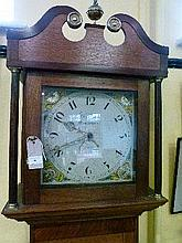 Early 19th Century oak and mahogany crossbanded longcase clock, the square painted dial having date aperture, hood with swan neck pediment, fluted col