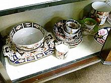 Collection of Derby and other 19th Century English porcelain tableware, mostly decorated in the Imari palette (one shelf)