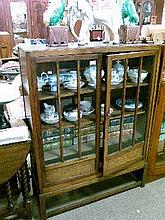 1930's period oak bookcase fitted three shelves enclosed by a pair of glazed doors