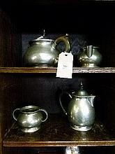 Early 20th Century Liberty & Co English pewter hammered four piece tea set, the base stamped 1075