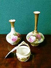 Two Royal Worcester vases, each painted with roses on a blush ground, shape numbers 702 and 1748, date codes for 1917 and 1912 together with a small R