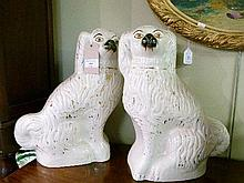 Pair of 19th Century Staffordshire pottery comforter spaniels, each having gilt flecked decoration