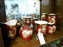 Five various Crown Devon ruby lustre ware vases decorated with various patterns