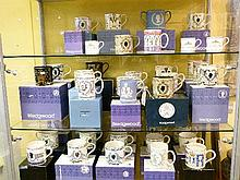 Large collection of modern Wedgwood limited edition Royal commemorative tankards, mugs and loving cups, mostly boxed (three shelves)