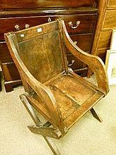 Late 19th/early 20th Century oak Glastonbury arm chair