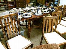 1930's period dark oak dining suite comprising: drawleaf table and four wavy back chairs having drop-in seats and two other dining chairs