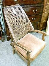 1930's period oak framed cane back fireside elbow chair