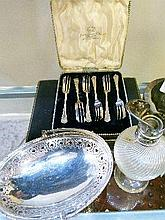 Set of six silver handled cake knives, cased, a set of silver plated pastry forks, cased, a silver plated oval basket with swing handle and a moulded