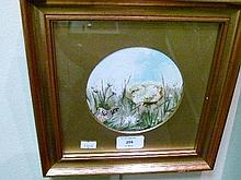20th Century circular oil on board - A Chick And Butterfly, framed and glazed