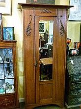 Early 20th Century oak single wardrobe fitted mirror panel door