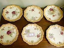 Set of eleven early 20th Century Continental porcelain plates, each having foliate decoration on a blush ground