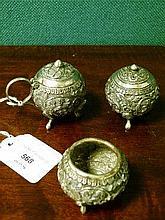 Indian white metal three piece condiment set having stylised foliate decoration