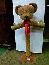 Merrythought teddy bear child's clothes stand formed as a teddy bear's head and outswept arms on a faux fur column