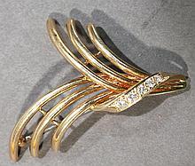DANKNER 14K GOLD AND DIAMOND BLAZER PIN.  Triple swoosh set with five approx. fi