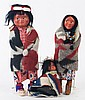 THREE SKOOKUM DOLLS. Various children with a