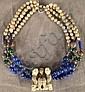 CHINESE NECKLACE.  With ivory polychrome netsuke, lapis, crystal, malacite and s
