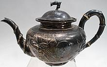 SILVERPLATED JAPANESE TEAPOT WITH IVORY HANDLED INSULATORS.  Handle, spout and lid are bamboo designs.  Body of teapot decorated with chrysanthemums.  (Note:  no makers marks).