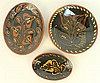 NED FOLTZ REDWARE SLIP DECORATED POTTERY.  Three black ground floral designs.  L