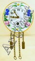 MINIATURE GERMAN ENAMEL CLOCK. Together with