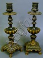 PAIR OF VICTORIAN BRONZE AND GILT CANDLESTICKS.
